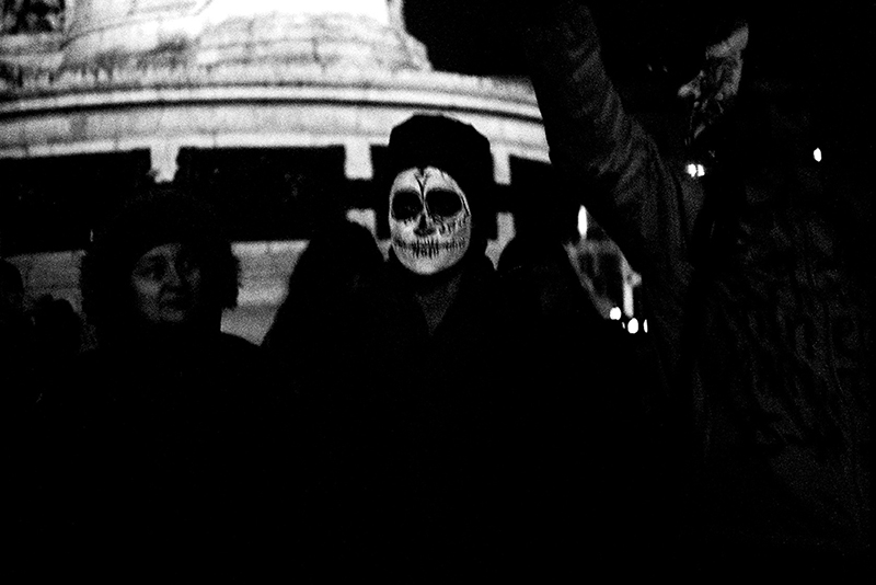 Artiviste with a mask during the 25 november demonstration against gender violence. Olenka Carrasco. The firstnames list.